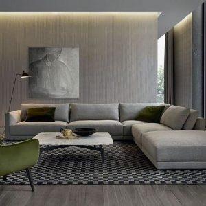 Modernistyczny salon nowoczesny z zielonym fotelem