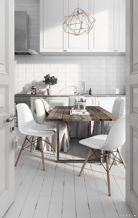 Białe krzesła przy stole